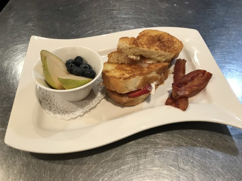 Strawberry Brie Breakfast Sandwich Bacon and Fruit Included at Good Medicine Lodge